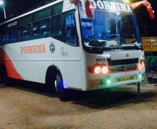 Hire Poornima Tours Bus
