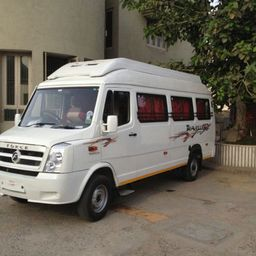 Hire 11 Seater Force Motors  A/C Bus in Ahmedabad