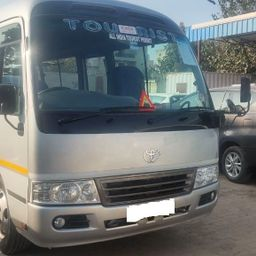 Hire 14 Seater Toyota  A/C Bus in Delhi NCR